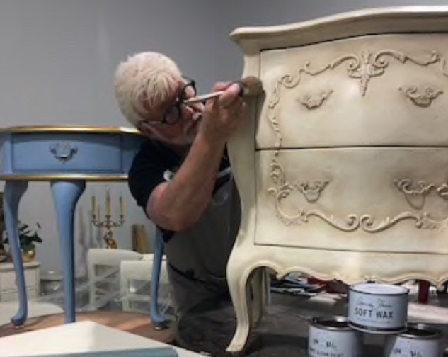 Jimmy Connelly working on an antique style dresser