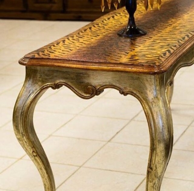 Jimmy has taken a French Provincial, cabriole leg table and created an eclectic statement piece